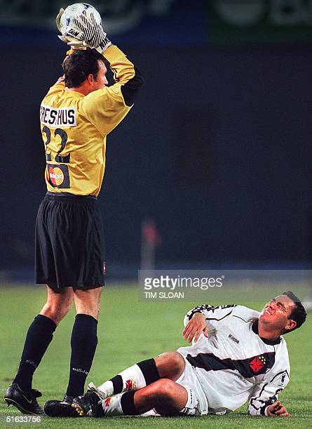 Vasco da Gama's Guilherme lies stunned on the ground after receiving a knee to the back from DC United goalie Tom Presthus during the Interamerican...