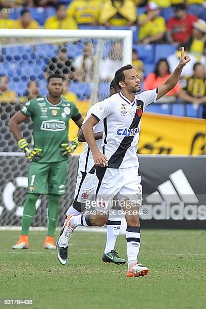 Vasco da Gama's Nene celebrates a goal against against Barcelona S.C., goalkeeper Maximo Banguera in the first half of the quarter-finals of a...