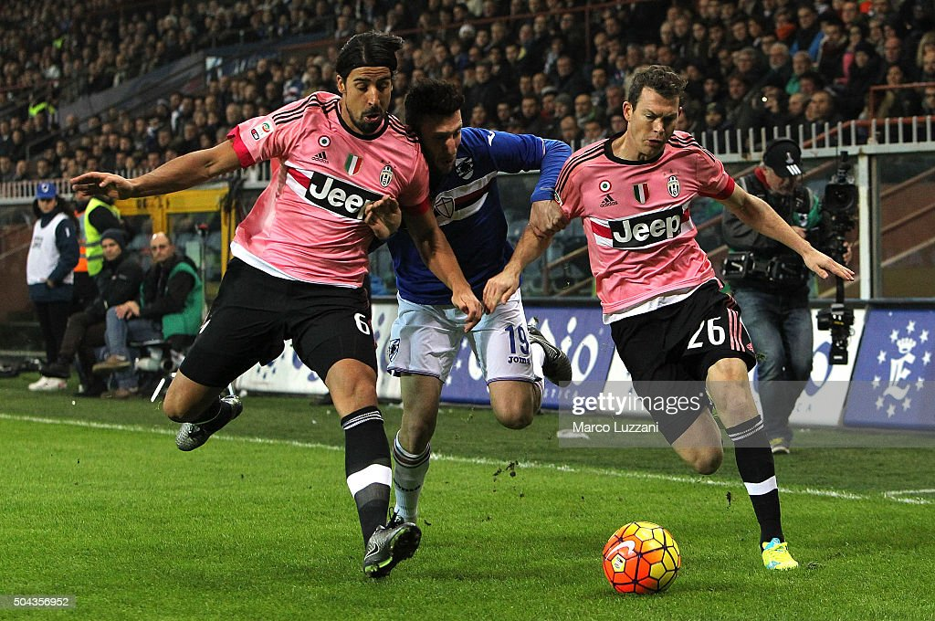 Vasco Regini (C) of UC Sampdoria competes for the ball with Sami Khedira (L) and Stephan Lichtsteiner (R) of Juventus FC during the Serie A match between UC Sampdoria and Juventus FC at Stadio Luigi Ferraris on January 10, 2016 in Genoa, Italy.