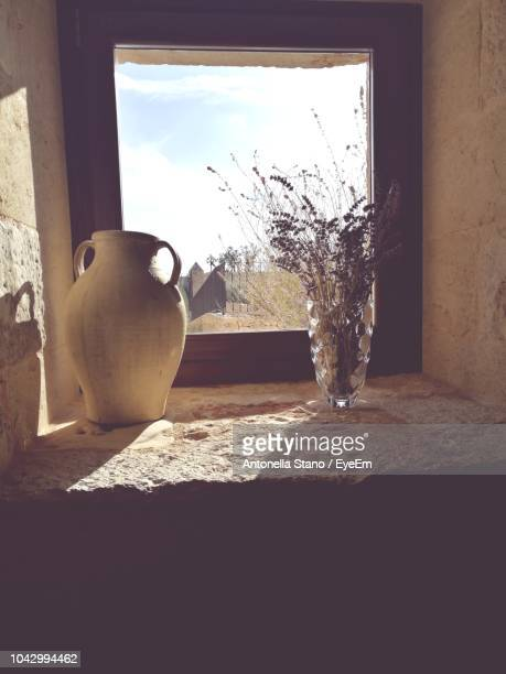 Vase And Pitcher On Window Sill