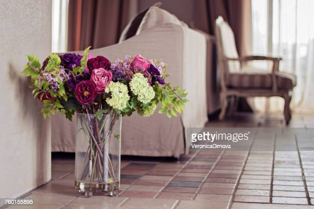 Vase filled with artificial flowers in a living room