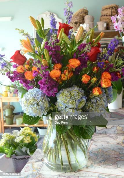 vase of fresh garden flowers - purple roses bouquet ストックフォトと画像