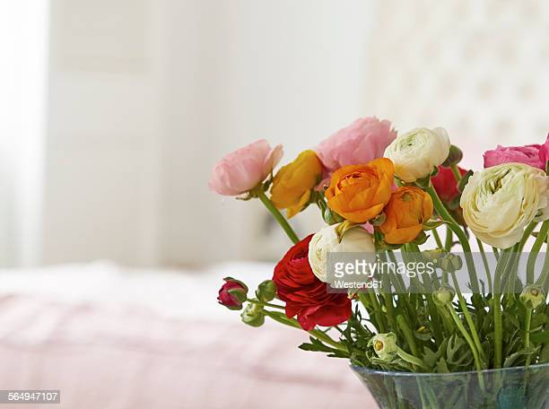 Vase with bunch of Persian buttercups