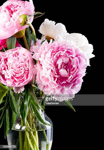 Vase with part of peony bouquet.