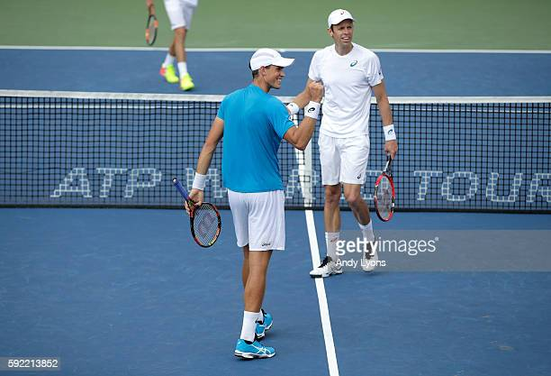 Vasek Pospisil and Daniel Nestor of Canada celebrate after beating PierreHugues Herbert and Nicolas Mahut of France 64 46 106 during day 7 of the...