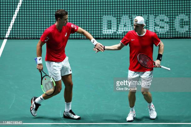 Vasek Pospisil and Denis Shapovalov of Canada celebrate a point in the quarter final doubles match between Australia and Canada during Day Four of...