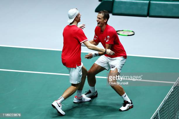 Vasek Pospisil and Denis Shapovalov of Canada celebrate winning the match in the quarter final doubles match between Australia and Canada during Day...