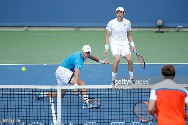 Vasek Pospisil hits the ball with his partner Daniel Nestor in their match against PierreHugues Herbert and Nicolas Mahut of France which they won 64...