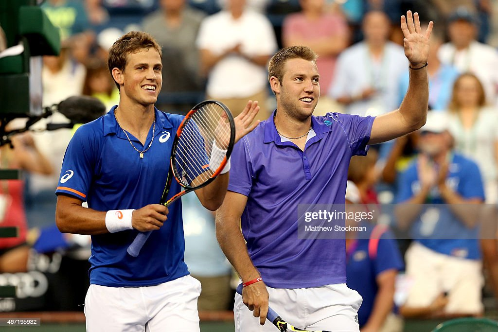 Vasek Pospisil of Canada and Jack Sock celebrate their win over Simone Bolelli and Fabio Fognini of Italy during the doubles final on day thirteen of the BNP Paribas Open at the Indian Wells Tennis Garden on March 21, 2015 in Indian Wells, California.