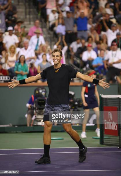 Vasek Pospisil of Canada celebrates match point against Andy Murray of Great Britain in their second round match during day six of the BNP Paribas...