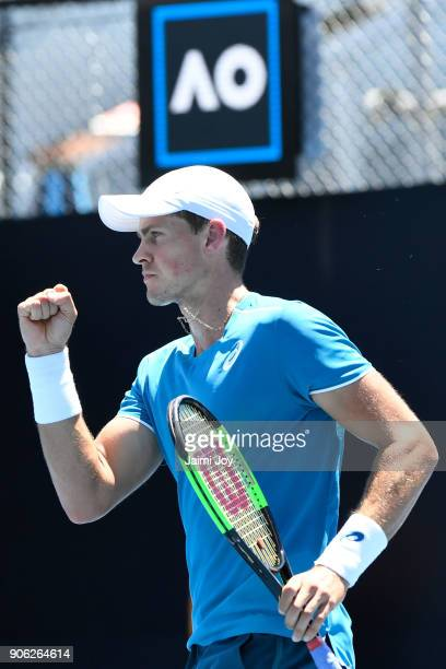 Vasek Pospisil of Canada celebrates winning a point in his first round men's doubles match with Ryan Harrison of the United States against Rohan...