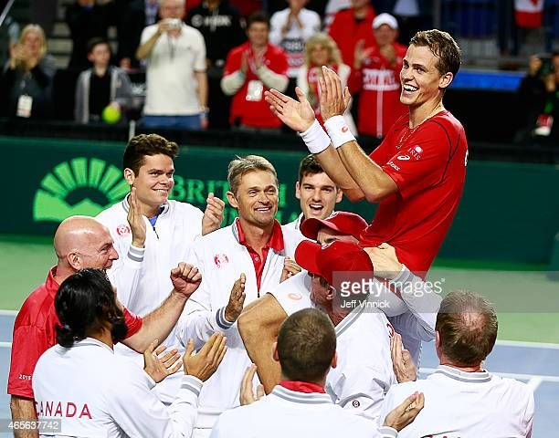 Vasek Pospisil of Canada is carried on the shoulders of his teammates as they celebrate his Davis Cup match win over Go Soeda of Japan March 8 2015...