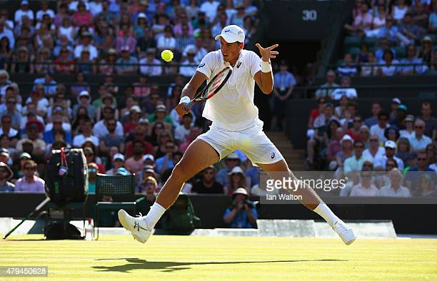 Vasek Pospisil of Canada plays a backhand in his Mens Singles Third Round match against James Ward of Great Britain during day six of the Wimbledon...
