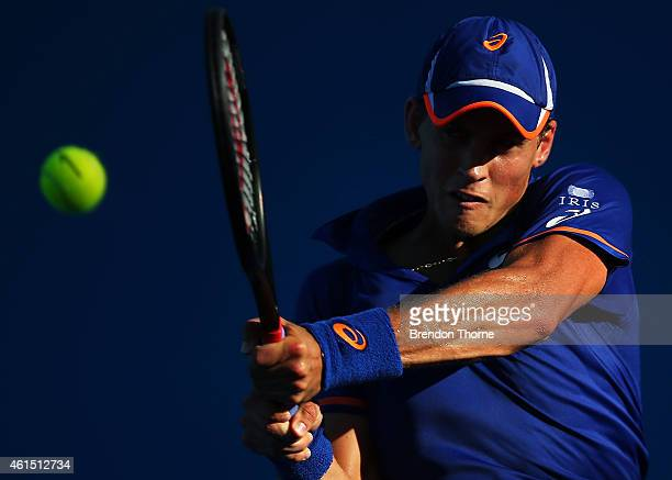 Vasek Pospisil of Canada plays a backhand in his second round match against Julien Benneteau of France during day four of the 2015 Sydney...