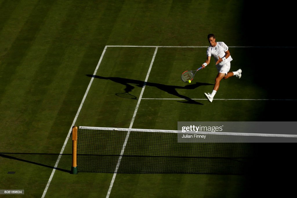 Vasek Pospisil of Canada plays a forehand during the Gentlemen's Singles first round match against Dominic Thiem of Austria on day two of the Wimbledon Lawn Tennis Championships at the All England Lawn Tennis and Croquet Club on July 4, 2017 in London, England.