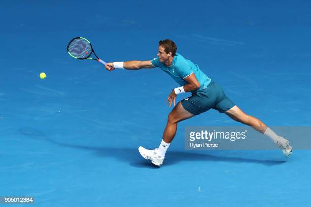 Vasek Pospisil of Canada plays a forehand in his first round match against Marin Cilic of Croatia on day one of the 2018 Australian Open at Melbourne...