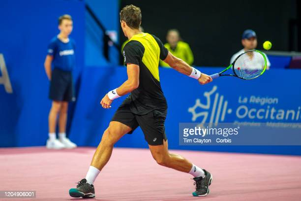 Vasek Pospisil of Canada plays an incredible reverse shot against David Goffin of Belgium in the Semi Finals of the Open Sud de France Tennis...