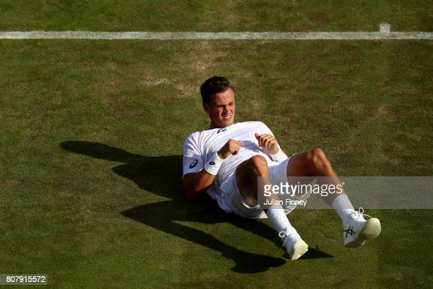 Vasek Pospisil of Canada reacts during the Gentlemen's Singles first round match against Dominic Thiem of Austria on day two of the Wimbledon Lawn...
