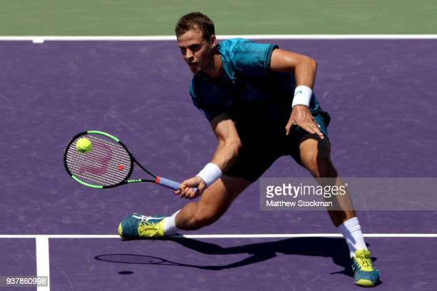 Vasek Pospisil of Canada returns a shot against Marin Cilic of Croatia during the Miami Open Presented by Itau at Crandon Park Tennis Center on March...