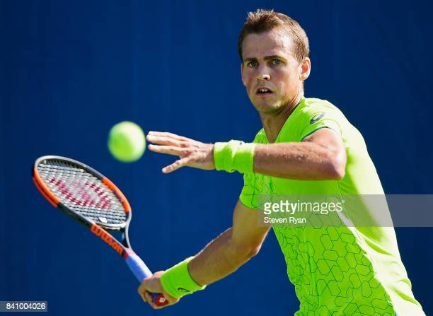 Vasek Pospisil of Canada returns a shot to Fernando Verdasco of Spain during their first round Men's Singles match on Day Three of the 2017 US Open...