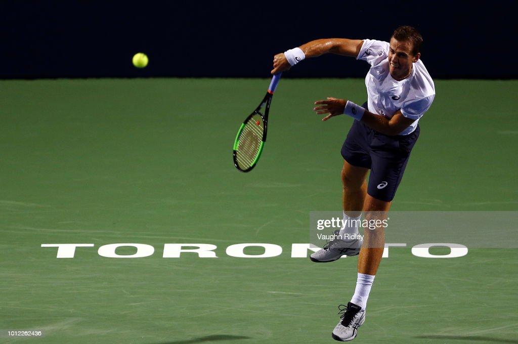 Vasek Pospisil of Canada serves against Borna Coric of Croatia during a 1st round match on Day 1 of the Rogers Cup at Aviva Centre on August 6, 2018 in Toronto, Canada.