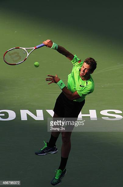 Vasek Pospisil of Canada serves during his match against Santiago Giraldo of Columbia during the day 3 of the Shanghai Rolex Masters at the Qi Zhong...