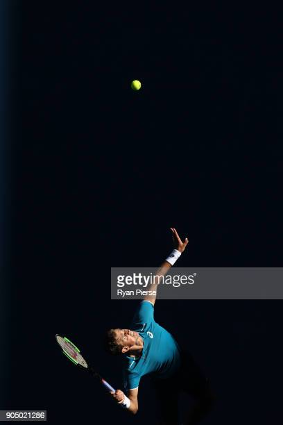 Vasek Pospisil of Canada serves in his first round match against Marin Cilic of Croatia on day one of the 2018 Australian Open at Melbourne Park on...