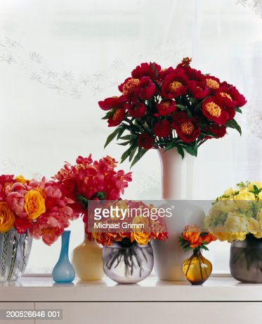 Vases Of Flowers On Window Sill Stock Photo Getty Images