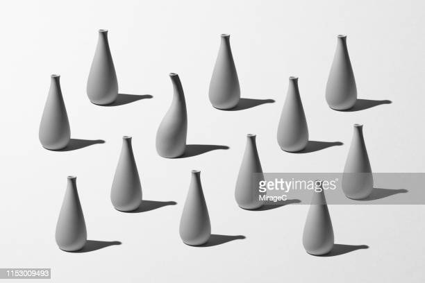vases standing out from the crowd - modern art stock pictures, royalty-free photos & images