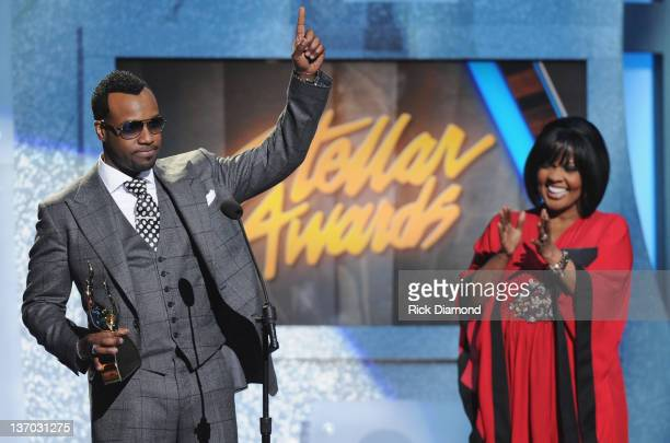 VaShawn Mitchell accepts ATT Artist of the Year award presented to him by CeCe Winans during the 27th Annual Stellar Awards at the Grand Ole Opry...