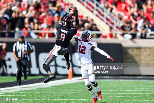 J Vasher of the Texas Tech Red Raiders makes a leaping catch against Tyler Rios of the Lamar Cardinals during the first half of the game on September...