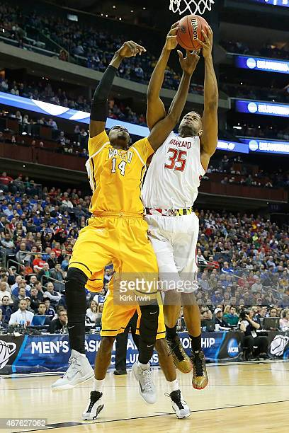Vashil Fernandez of the Valparaiso Crusaders and Damonte Dodd of the Maryland Terrapins battle for control of the ball during the second round of the...