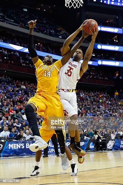 Vashil Fernandez of the Valparaiso Crusaders battles for a rebound with Damonte Dodd of the Maryland Terrapins during the second round of the Men's...