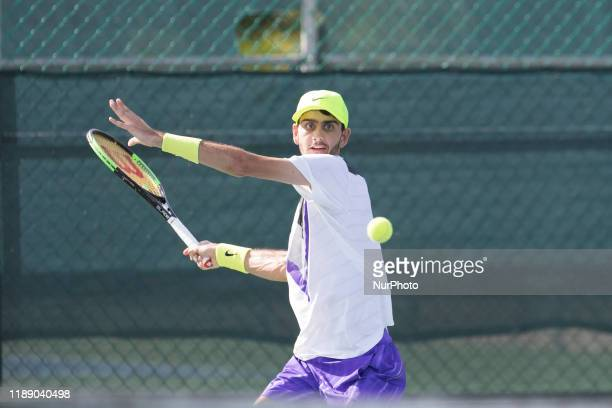 Vasil Kirkov of USA plays a backhand in the match Singles Finals against Nick Chappell of USA during The World Tennis Tournament Cancun 2019 on...