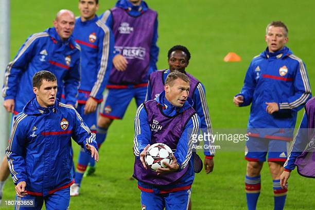 Vasili Berezutski holds the ball during a CSKA Moscow training session ahead of their UEFA Champions League Group D match against Bayern Muenchen at...