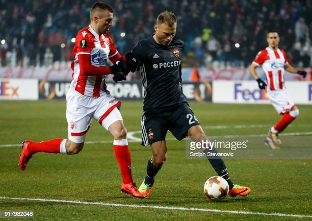 Vasili Berezutski of CSKA Moscow in action against Nenad Krsticic of Crvena Zvezda during the UEFA Europa League Round of 32 match between Crvena...