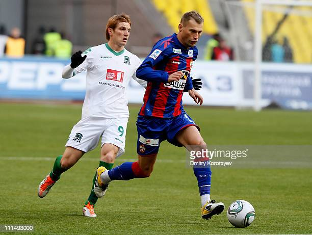 Vasili Berezutski of PFC CSKA Moscow battles for the ball with Igor Picusceac of FC Krasnodar during the Russian Football League Championship match...