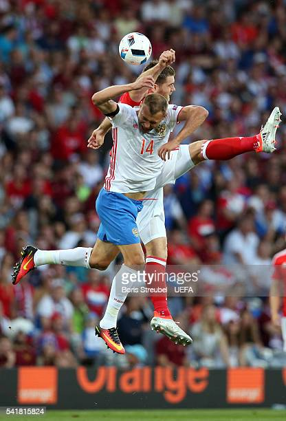 Vasili Berezutski of Russia and Chris Gunter of Wales compete for the ball during the UEFA EURO 2016 Group B match between Russia and Wales at...