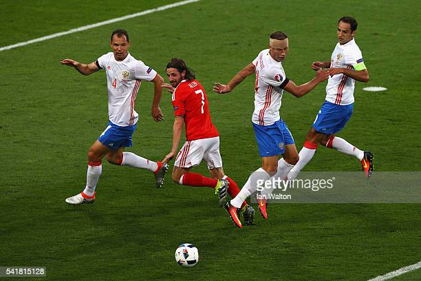 Vasili Berezutski of Russia and Joe Allen of Wales compete for the ball during the UEFA EURO 2016 Group B match between Russia and Wales at Stadium...