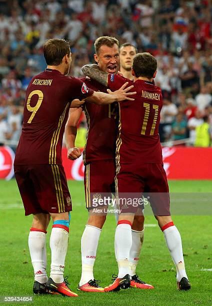Vasili Berezutski of Russia celebrates as he scores his team's first goal with his team mates Aleksandr Kokorin and Pavel Mamaev during the UEFA EURO...