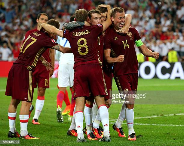 Vasili Berezutski of Russia celebrates with team mates as he scores his team's first goal during the UEFA EURO 2016 Group B match between England and...
