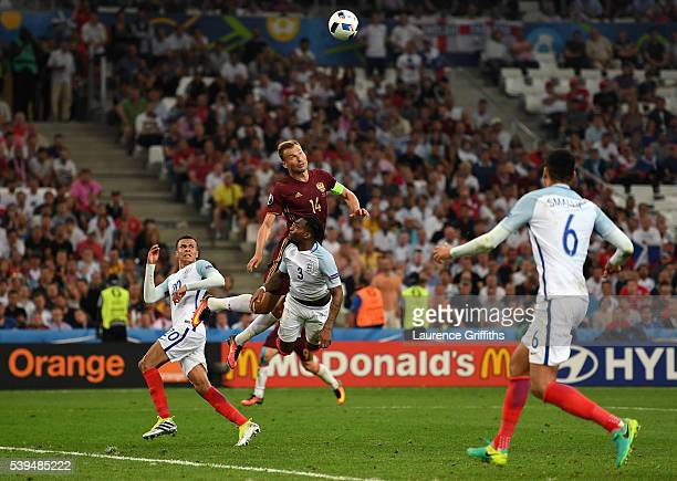 Vasili Berezutski of Russia heads the ball to score his team's first goal during the UEFA EURO 2016 Group B match between England and Russia at Stade...