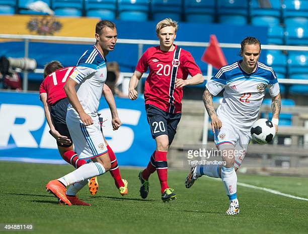 Vasili Berezutski of Russia Mats Daehli of Norway and Andrey Eshchenko of Russia in action during the International Friendly match between Norway and...