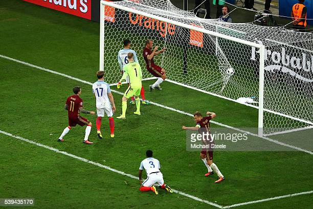 Vasili Berezutski of Russia scores his team's first goal during the UEFA EURO 2016 Group B match between England and Russia at Stade Velodrome on...