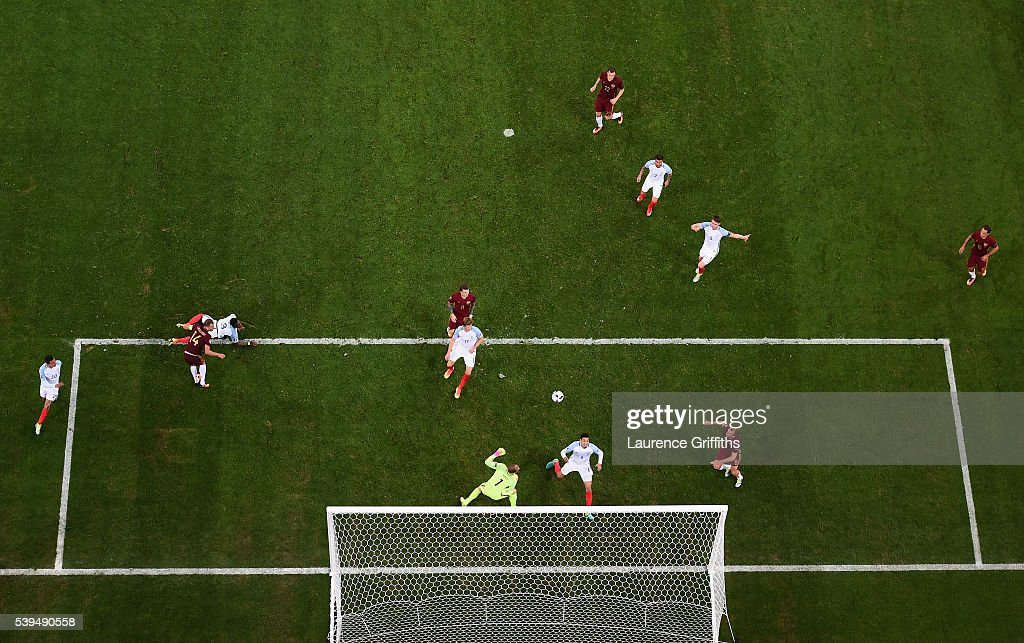 Vasili Berezutski of Russia scores the equalising goal past Joe Hart of England during the UEFA EURO 2016 Group B match between England and Russia at Stade Velodrome on June 11, 2016 in Marseille, France.