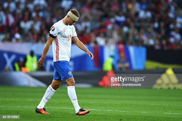 Vasili Berezutski of Russia walks off the pitch during the UEFA EURO 2016 Group B match between Russia and Wales at Stadium Municipal on June 20,...