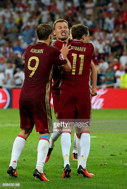 Vasili Berezutski Russian celebrates as he scores their first goal with Aleksandr Kokorin and Pavel Mamaev during the UEFA EURO 2016 Group B match...