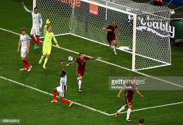 Vasili Berezutski scores his team's first goal during the UEFA EURO 2016 Group B match between England and Russia at Stade Velodrome on June 11, 2016...