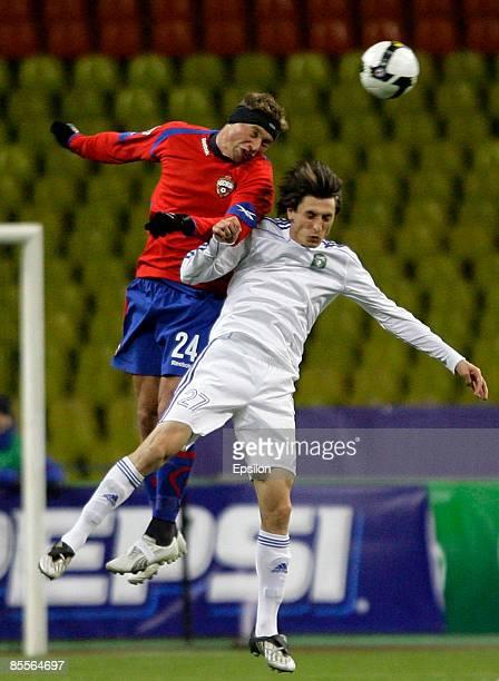 Vasili Berezutskiy of CSKA Moscow battles for the ball with Goran Maznov of FC Tom Tomsk during the Russian Football League Championship match...