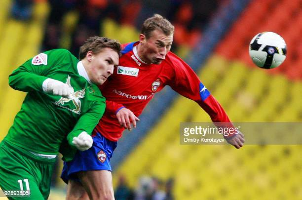 Vasili Berezutskiy of PFC CSKA Moscow competes for the ball with Aleksandr Bukharov of FC Rubin Kazan during the Russian Football League Championship...